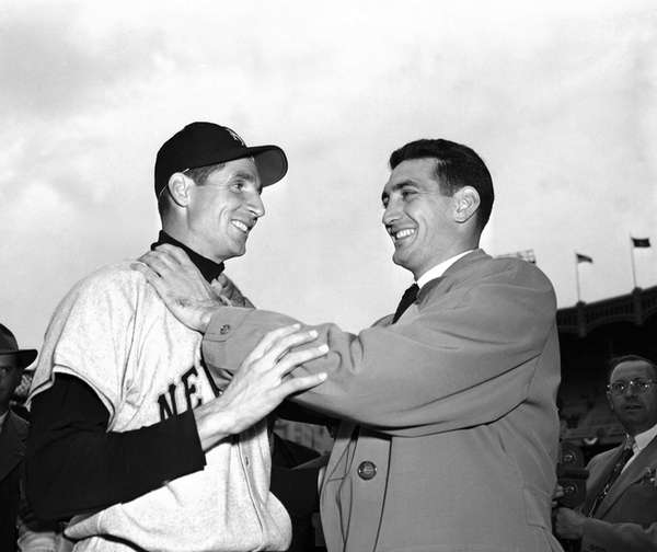 Bobby Thomson, left, of the New York Giants,