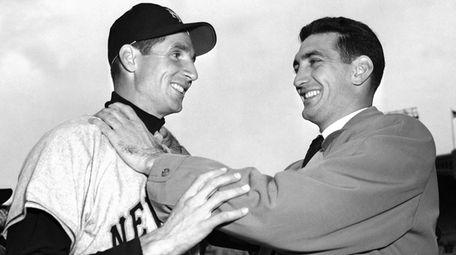 Bobby Thomson, left, of the New York Giants,