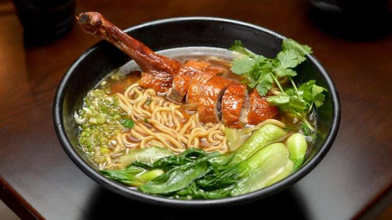 Roast duck noodle soup with an extra helping