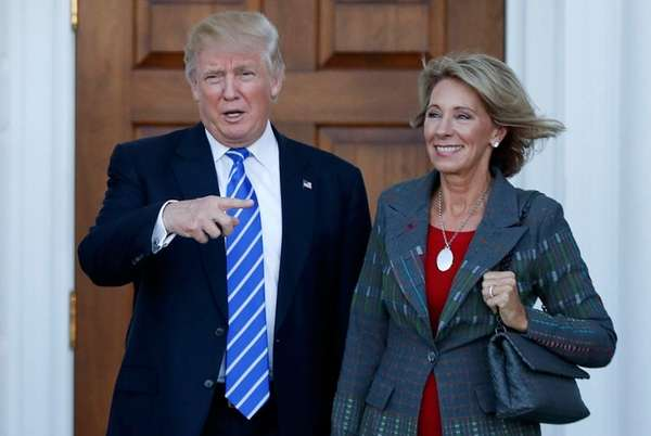 President-elect Donald Trump and Betsy DeVos pose for