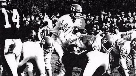 East Islip quarterback Fred Heller calls signals behind