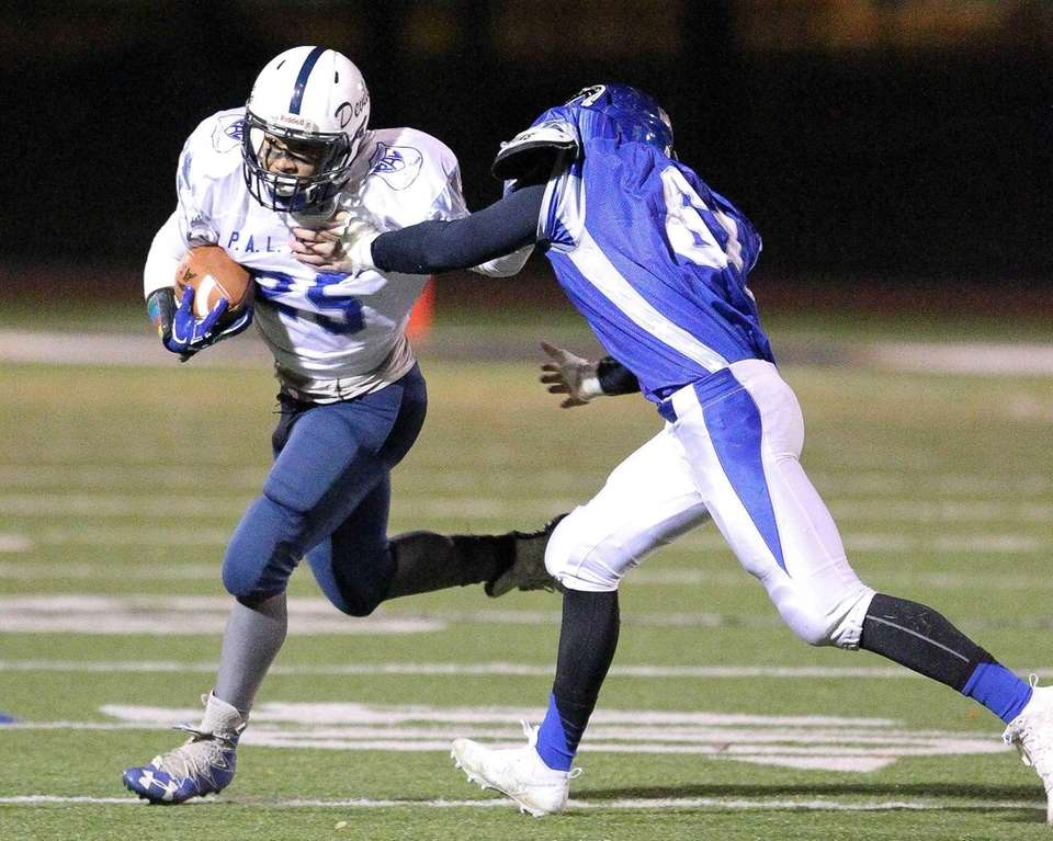 Huntington's Kieron Byrams runs the ball and gets