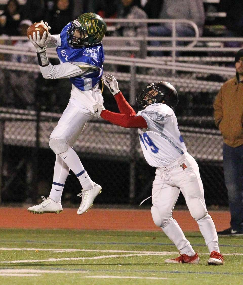 Ward Melville's Dominic Pryor grabs a pass for