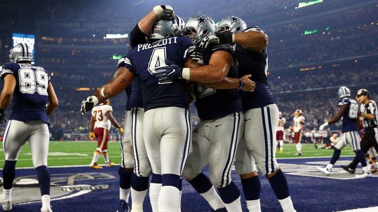 Dak Prescott #4 of the Dallas Cowboys celebrates