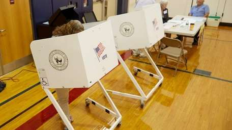 A woman votes in the primary election in