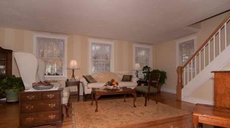 The living room in the three-bedroom Colonial in