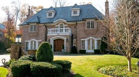This five-bedroom Colonial on Walter Lane in Manhasset