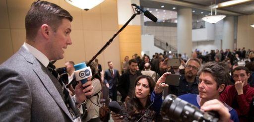 Richard Spencer, left, talks to the media at