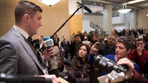 Richard Spencer, left, talks to the media at