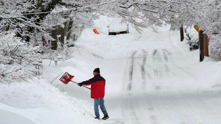 Dennis Palmer digs out his driveway on South