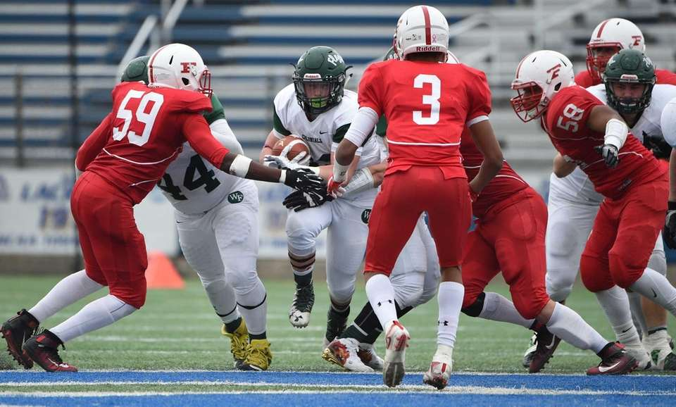 William Floyd's running back Nick Silva looks for
