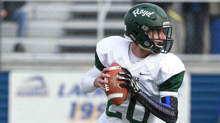 Floyd quarterback Robert Taiani looks to pass against