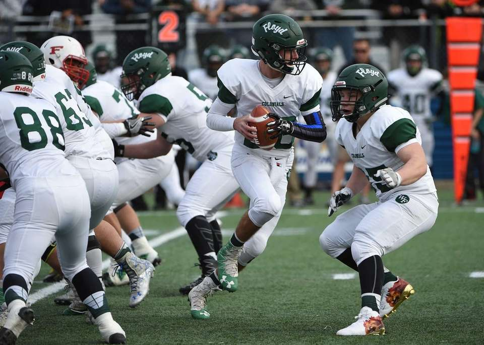 William Floyd quarterback Robert Taiani scrambles against Freeport