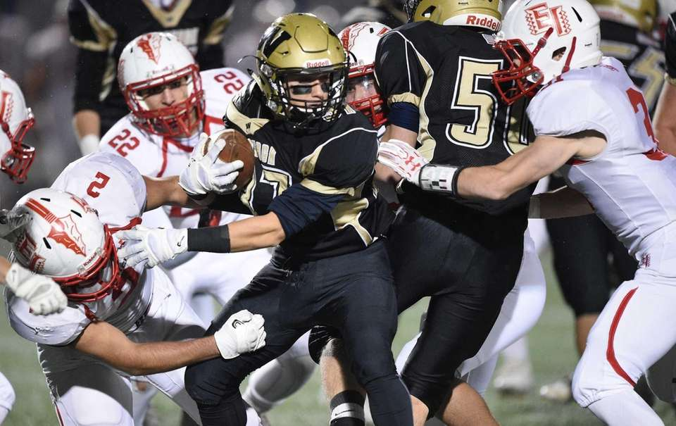 Wantagh's Anthony D'Onofrio is surrounded by the East