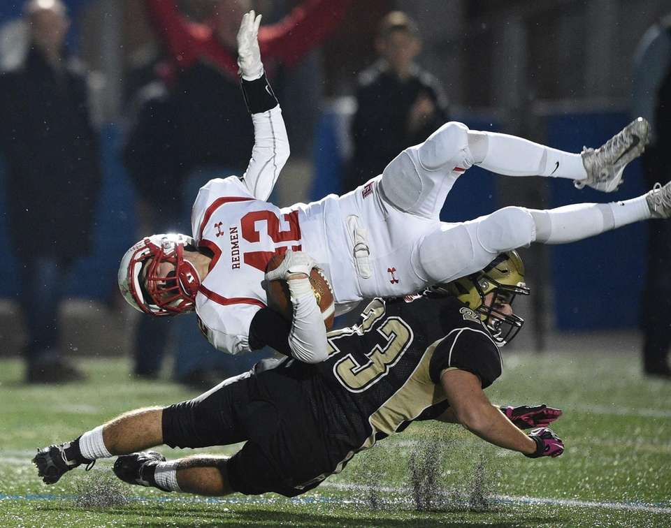 Wantagh's Devin Kennedy tackles East Islip's Justin Orobello