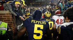 Jabrill Peppers of the Michigan Wolverines leaves the