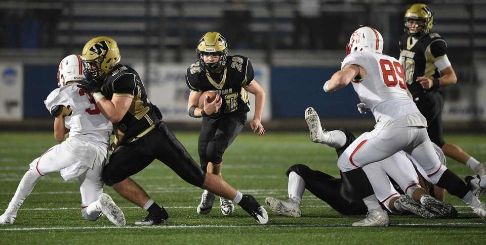 Wantagh's Tommy Rohan runs the ball against East