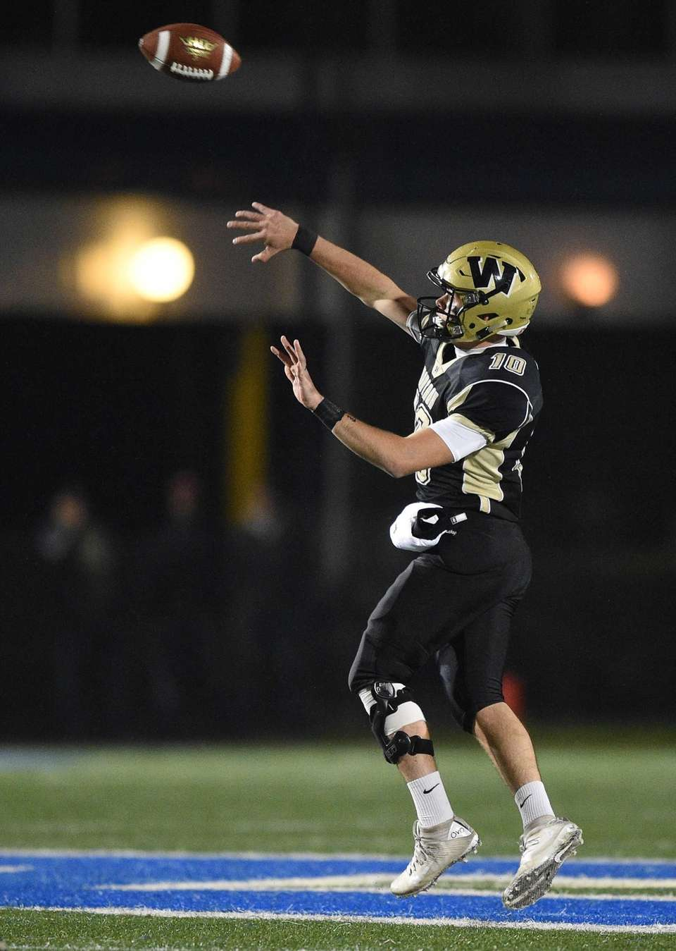 Wantagh quarterback Jake Castellano passes the football against