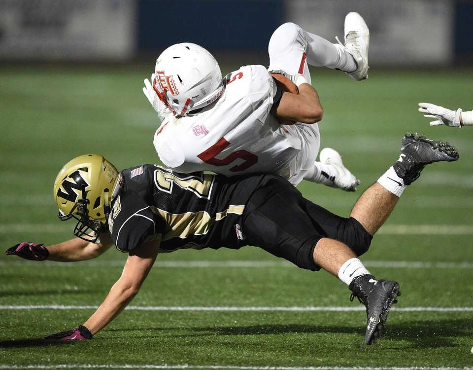 Wantagh's Devin Kennedy upends East Islip's Justin Taveras