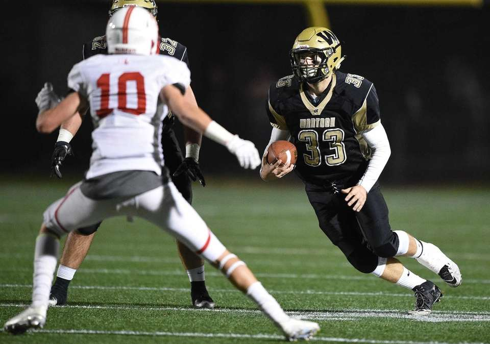 Wantagh's Sam Sloves runs the ball against East