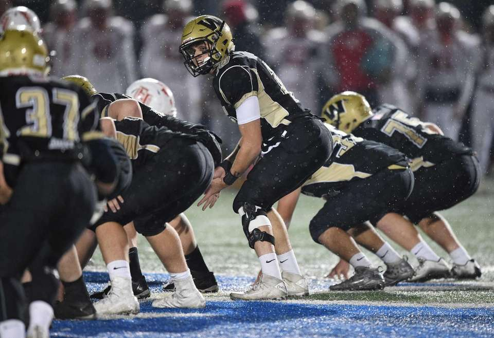 Wantagh quarterback Jake Castellano sets for a snap