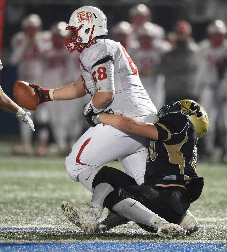 Wantagh's Joe Valenti tackles East Islip's Kyle Nunez