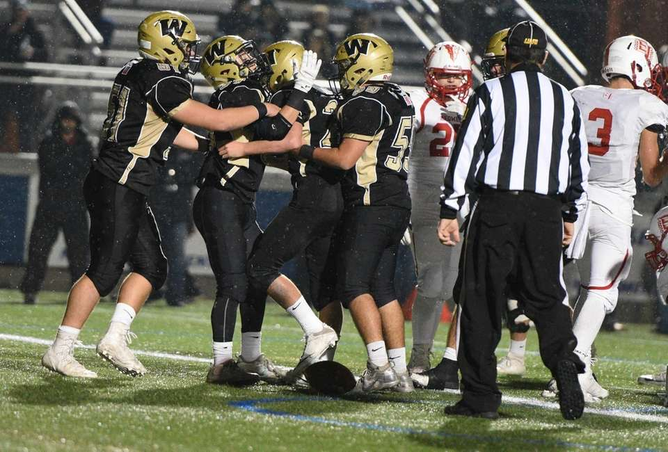 Wantagh players congratulate Tommy Rohan after he scores