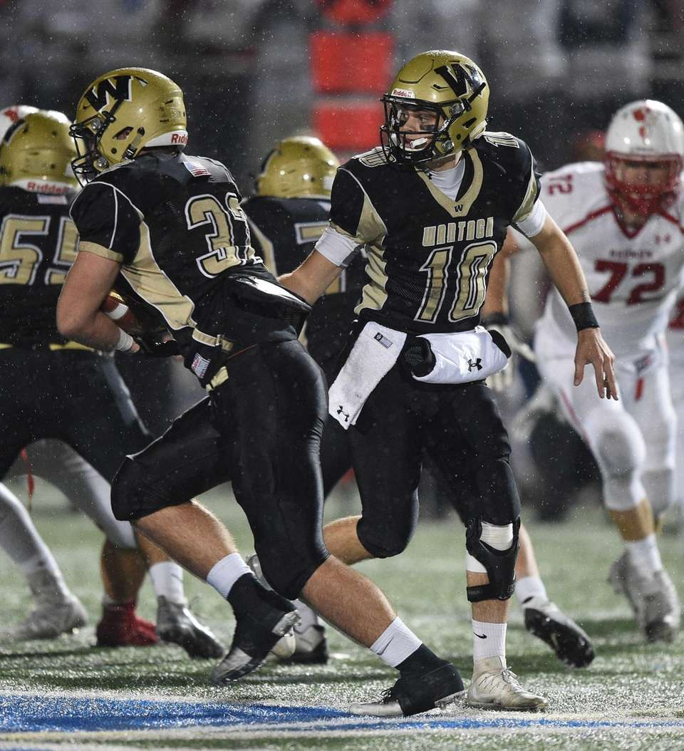 Wantagh quarterback Jake Castellano hands the ball off
