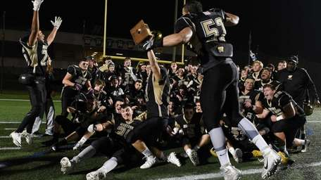 Wantagh players celebrate after their 21-14 win against