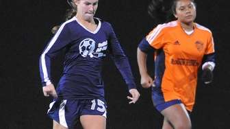 Nikki Beatty of Patchogue-Medford moves the ball downfield