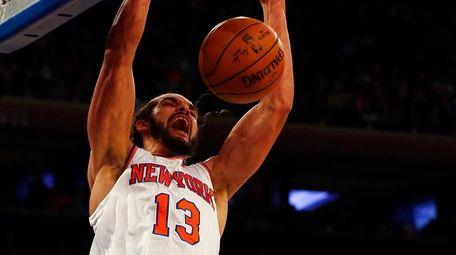 Joakim Noah of the New York Knicks dunks