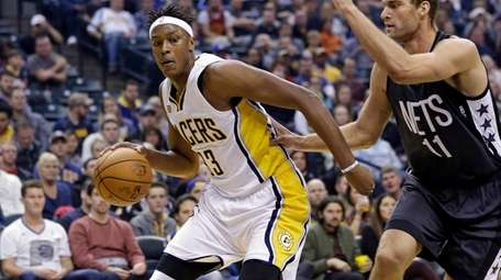 Indiana Pacers center Myles Turner, left, drives inside