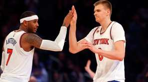 Carmelo Anthony and Kristaps Porzingis celebrate after