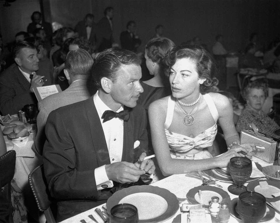 Frank Sinatra and Ava Gardner dine at the