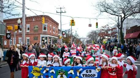 Sayville Girl Scout Troop 3769 walks with a