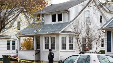 Police investigate a fire at 55 Roger Place