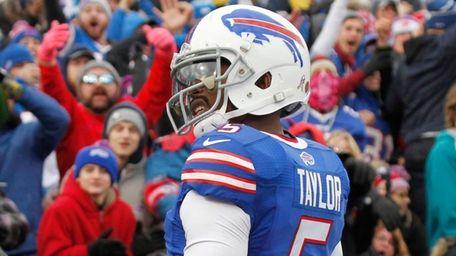 Buffalo Bills quarterback Tyrod Taylor (5) celebrates after