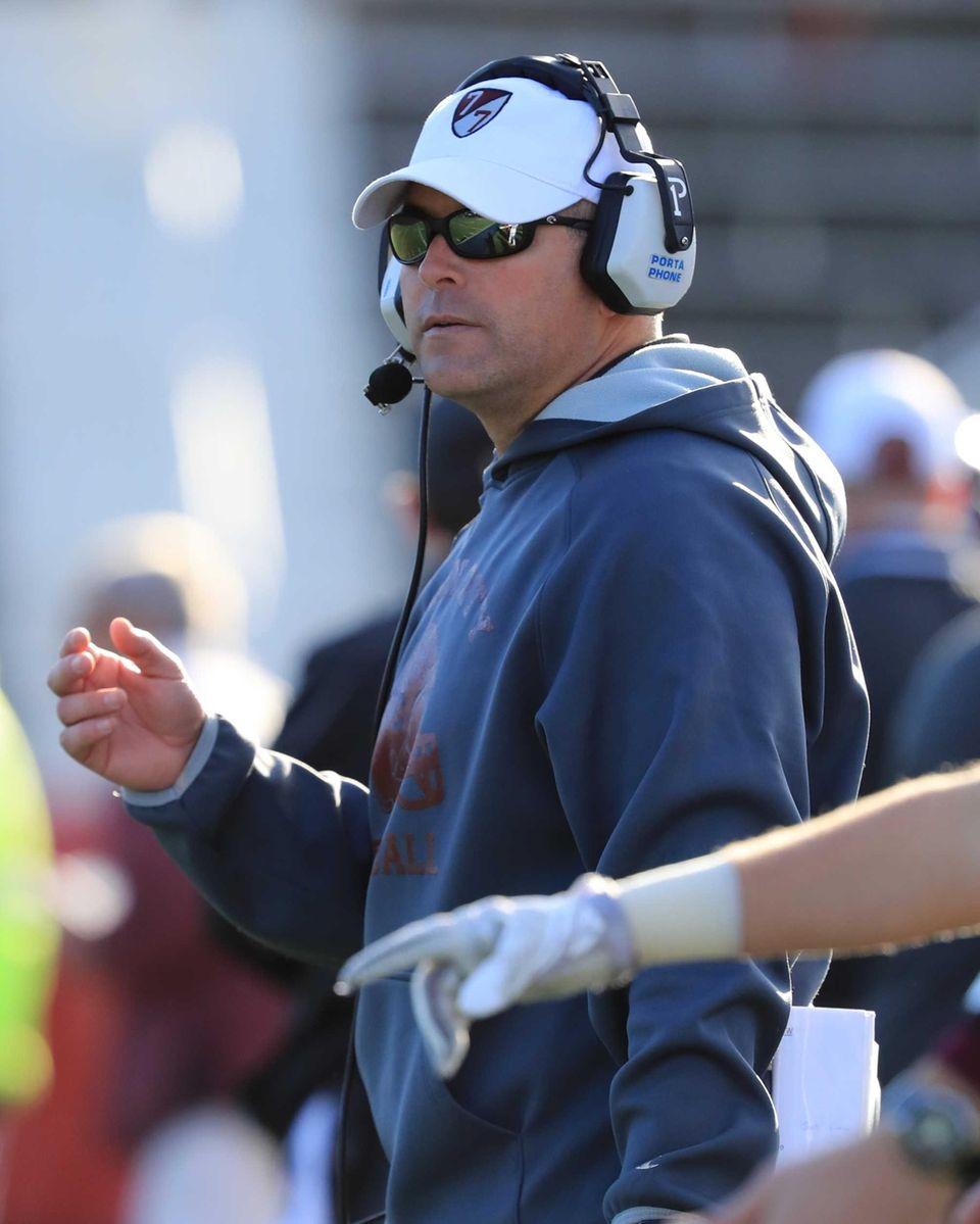 Garden City head coach Dave Ettinger watches from
