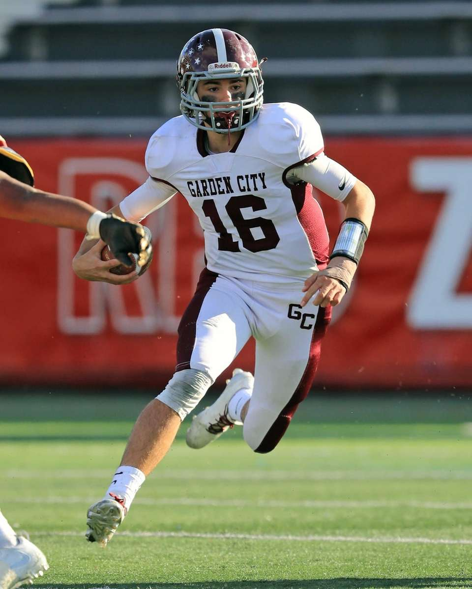 Garden City quarterback Jack Bill rushes with the