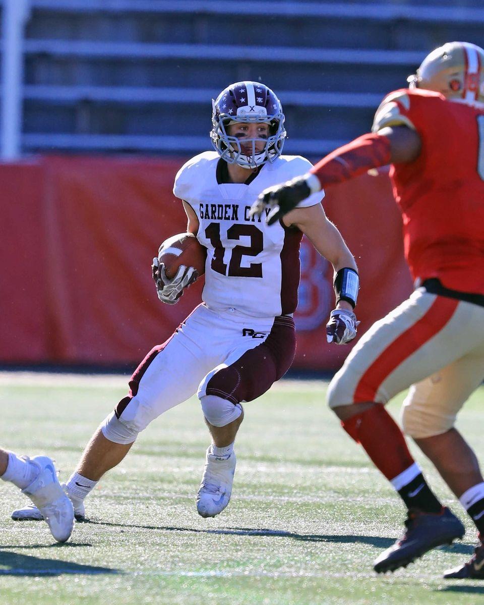 Garden City's Tyler Wuchte runs with the ball