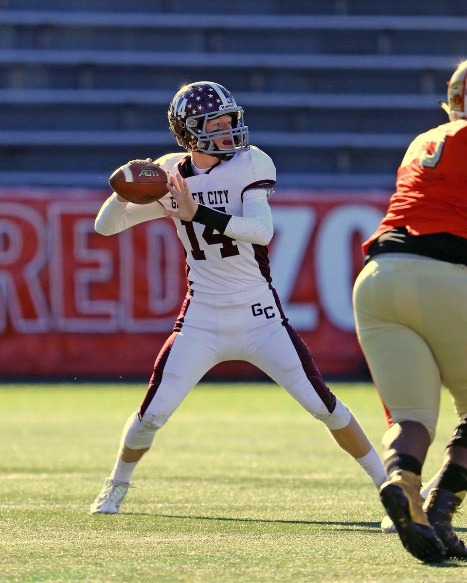 Garden City quarterback Colin Hart drops back to