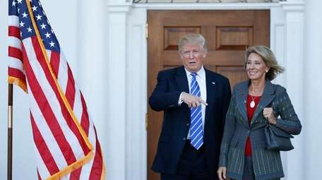 Donald Trump with Betsy DeVos, his pick to