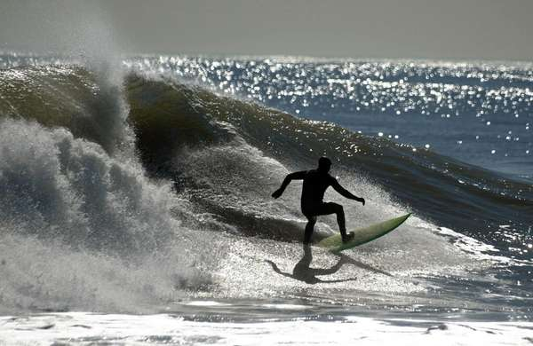 This surfer catches a wave in Long Beach.