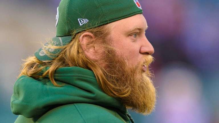 New York Jets center Nick Mangold looks on