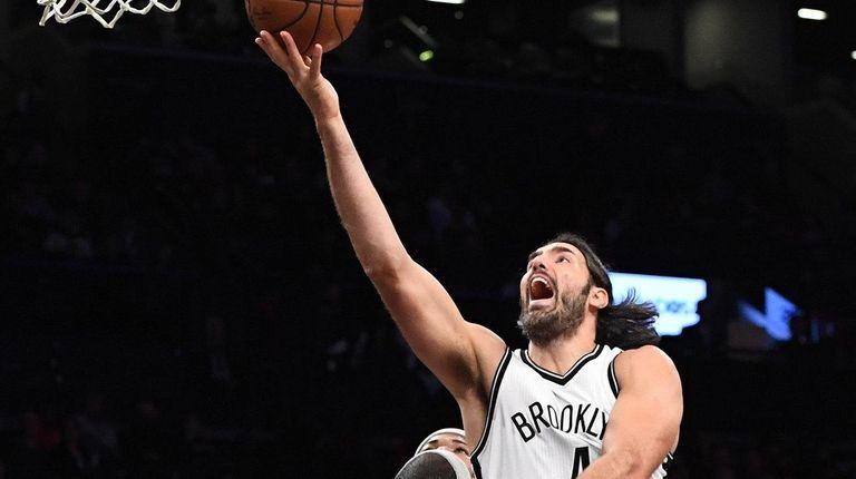 Brooklyn Nets forward Luis Scola attempts a layup