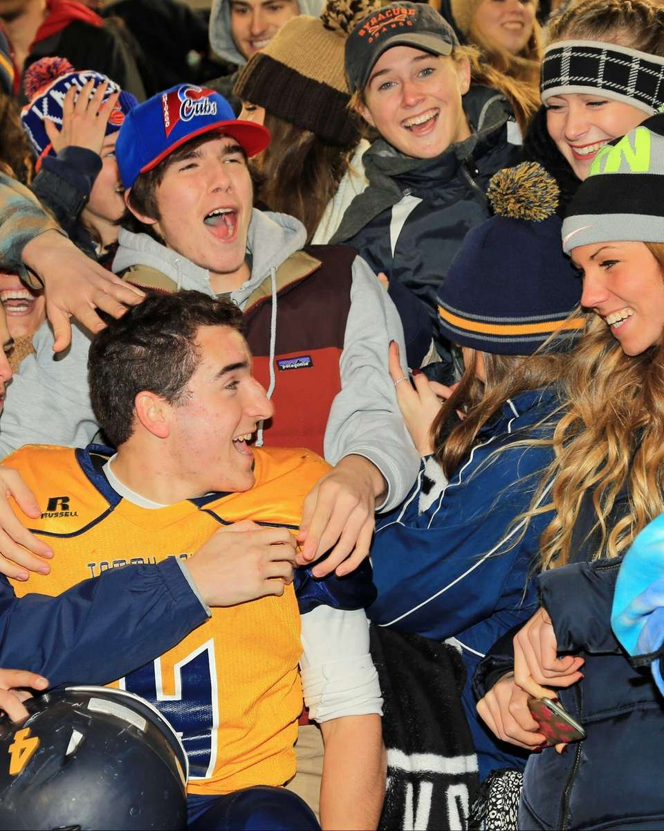 Shoreham-Wading River's Chris Gray celebrates with fans following