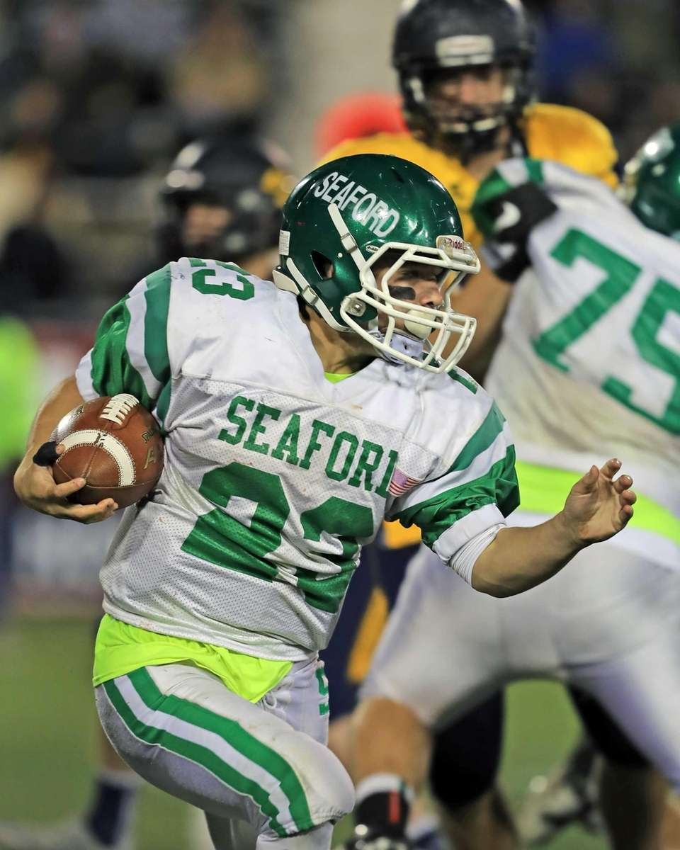Seaford's Danny Roell rushes during the second half
