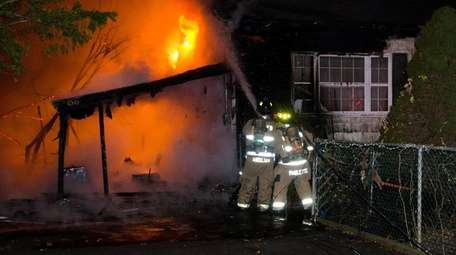 Firefighters from multiple departments battled a house fire