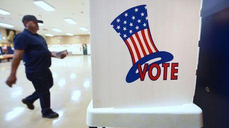 A man arrives to vote on Nov. 8,