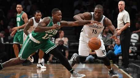 Brooklyn Nets guard Isaiah Whitehead battles for the